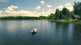 Top view of happy couple in a boat on lake. stock footage