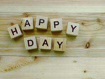 Happy day wooden block alphabet on wooden background. Top view of happy day wooden block alphabet on wooden background royalty free stock photos