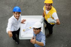 Top view of happy Engineer team thumbs up stock photos