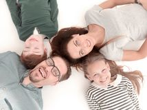 Top view. happy family lying on the floor stock images