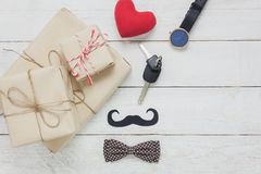 Top view Happy Father day.accessories with red heart. Top view Happy Father day.accessories with red heart,mustache,vintage bow tie,present,key`s car on rustic Stock Photography