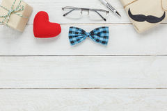 Top view Happy Father day.accessories with red heart. Top view Happy Father day.accessories with red heart,mustache,vintage bow tie,present,pen on rustic white Royalty Free Stock Photography