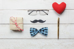 Top view Happy Father day.flat lay accessories. Top view Happy Father day.flat lay accessories with red heart,mustache,vintage bow tie,present,pen on rustic Stock Images