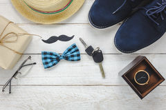 Top view Happy Father day on rustic wooden. Top view Happy Father day on rustic wooden background. accessories with watch,mustache,vintage bow tie,pen,present Royalty Free Stock Photography