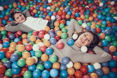 Top view. Happy mom and son in pool with balls. Family rest, leisure. Spending holiday together with family. Entertainment center, mall, amusement park stock images