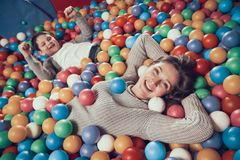 Top view. Happy mom and son in pool with balls. Family rest, leisure. Spending holiday together with family. Entertainment center, mall, amusement park royalty free stock image