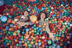 Top view. Happy mom and son in pool with balls. Family rest, leisure. Spending holiday together with family. Entertainment center, mall, amusement park stock photo