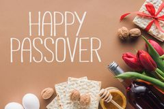 top view of happy passover greeting and matza on brown Passover royalty free stock photo