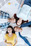 Top view of happy people lying on their drafts Royalty Free Stock Images