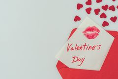 Top view of happy valentines day postcard with lips print in envelope. Isolated on white stock image