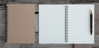 Top view of hardcover kraft notebook and ballpoint pen. Design concept - Top view of hardcover kraft notebook and ballpoint pen royalty free stock images