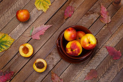 top view of the harvest of peaches and autumn leaves Royalty Free Stock Photography