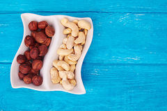 Top view at hazelnuts and cashew in wave plate Stock Photography