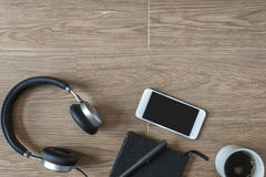 Top View of Headphone and Mobile Phone on Wood Background Royalty Free Stock Photo