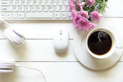 Free Top View Headphones On White Desk And Computer With Pink Flower And Copyspace Area For A Text And Cup Of Coffee Beside Headset. Stock Photography - 98704562