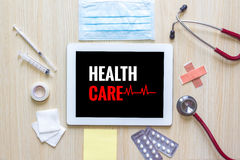 Top view of Health care word on tablet with stethoscope, hypoder Royalty Free Stock Photography