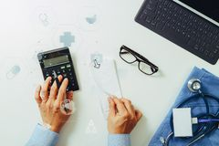 Top view of Healthcare costs and fees concept.Hand of smart doct Stock Photography
