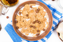Top view of healthy breakfast. Oat cereal granola in bowl on white wooden background royalty free stock photography