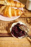 Top view of healthy breakfast with two croissants and marmalade on wooden table royalty free stock photos