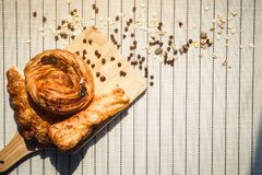 Healthy eating and traditional breakfast concept;. Top view of healthy eating and traditional bakery concept; fresh bread on the kitchen table with beverage at royalty free stock images
