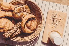 Top view of healthy eating and traditional bakery concept; fresh. Bread on the kitchen table with beverage at morning stock photography