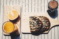 Top view of healthy eating and traditional bakery concept; fresh. Bread on the kitchen table with beverage at morning stock image