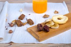 Healthy Food and Energetic Lifestyle Concept with Nuts and Fruit Stock Images