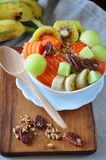 Top view of Healthy Fruits on Yogurt Bowl. Serve on wooden board stock image