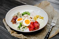 Top View Healthy Hearty Cobb Salad with Chicken, Bacon, Tomato, Onions, Eggs, green beans. American food. Close up, home. Made cuisine royalty free stock images