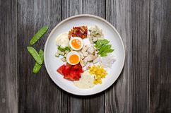 Top View Healthy Hearty Cobb Salad with Chicken, Bacon, Tomato, Onions, Eggs, green beans. American food. Close up, home. Made cuisine royalty free stock image