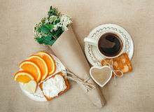Top View.Healthy Organic Breakfast.Cup og Coffee,Cut Orange,Biscuit with Cottage Cheese.Wish Card. With Flowers Royalty Free Stock Photo