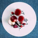 Red smoothie in glasses. Top view of healthy red smoothie in glasses and ingredients stock photography