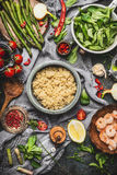 Top view of Healthy salad with asparagus and cooked quinoa seeds, preparation on rustic background with various organic vegetables. Vegetarian food and diet Stock Images