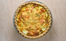 Top view of a healthy vegetarian spinach quiche pie fresh from t Stock Photo