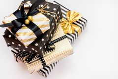 Top view of a heap of gift boxes in various black, white and golden designs. A concept of Christmas, New Year, birthday celebratio. N event royalty free stock image
