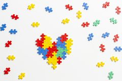 Top view on heart made of colorful plastic construction bricks on white background.  royalty free stock photo
