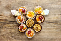 Top view on heart shape group of cupcakes Royalty Free Stock Photos
