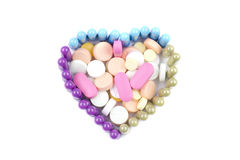 TOP VIEW OF HEART SHAPED PILLS. Top view of pills shaped in a heart with assorted pills, capsules and tablets inside Stock Photos
