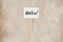 top view of hello lettering on placard stock photo