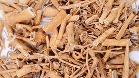 Herb medicine Baiqian or Cynanchi Stauntonii Rhizoma et Radix or Willowleaf Swallowwort Rhizome and Root rotating and pau. Top view herb medicine Baiqian or stock video footage