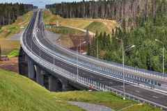 Top view of highway crossing forest, and bridge over river. Stock Photography