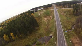 Top view of highway runs near village stock footage