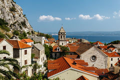 Top view of the historical part of the town of Omis and Holy Cross Church in Croatia stock images