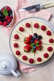 Top view holiday cake with berries on light background stock photography