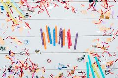 Holiday candles with confetti around Stock Image