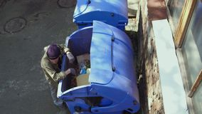Top view of homeless old man digging in trash can. stock footage