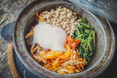 Top view of Homemade Bibimbap rice in pot. royalty free stock photography