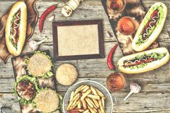 Top view homemade burgers with beef, hot dogs and beer on a wooden table. Rustic style. Rustic style, top view homemade burgers with beef, hot dogs and beer on a stock images