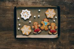 Gingerbreads on baking tray royalty free stock photos