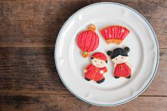 Top view of homemade gingerbread as Chinese boy and girl dolls i Royalty Free Stock Photography
